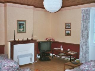 Sitting/Dining Room with satelite TV