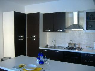 Fully fitted luxury kitchen with breakfast bar.