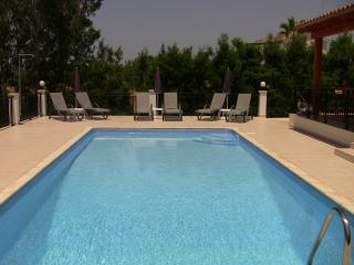 Relax on comfortable sun beds around the pool