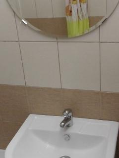 Shower at Olimpijskaya-89 (2-bedroom apartment)