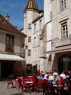 A cafe in the pedestrian area of Semur on a typical summer day.