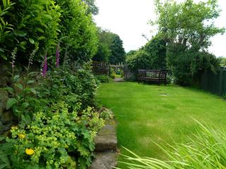 Relax in Foxglove Cottage's peaceful garden.