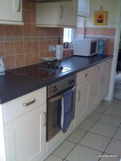 Kitchen, with integrated oven,ceramic hob, microwave large fridge freezer, washing machine,