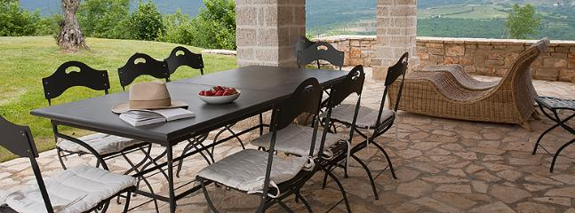 dinning table with great view over the gardens and pool