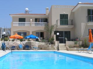 View of the lovely cristal clear pool.  Town house (C1 and C2) looking on to the pool .