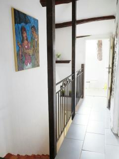 View of the hallway from little bedroom, bathroom at the end