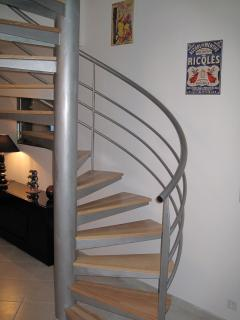 Feature spiral staircase leading to upstairs lounge and balcony