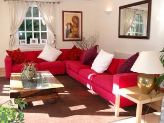Main living room with patio doors to front garden