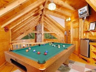This cabin has a pool table & wet bar in the loft which will off