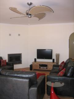 luxurious lounge, large TV with Freeview and woodburner