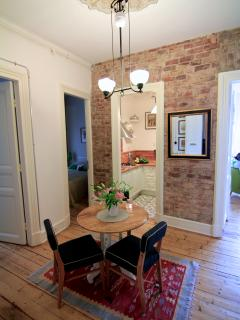 Dining area/entry with table, chairs and air-condition
