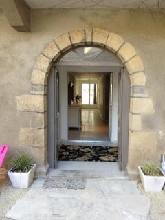 Arched rear door through to the courtyard & herb garden