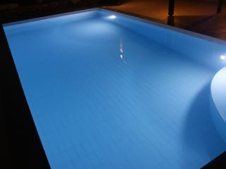 Fully tiled private pool with easy access steps and night ligthing