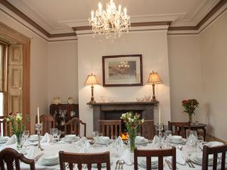 Dining room set for a celebration for14 people