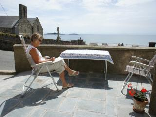 Outside is a slate patio overlooking the beach & Aberdaron Bay