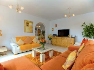 Comfortable lounge with flat screen TV/Sky, overlooks pool, jacuzzi, paddling pool, landscape views