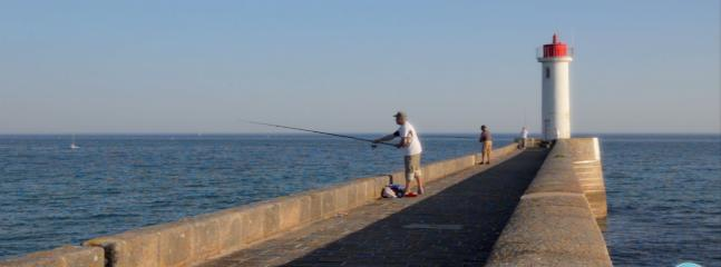 Fishing off the pier in Audierne