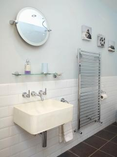 Main bathroom with wall hung basin and Grohe taps