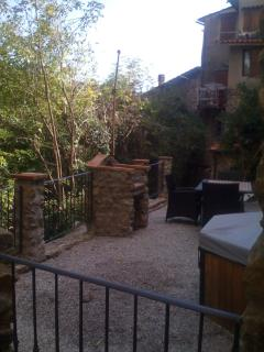 The backyard with the garden furnitures and the stone bbq + jacuzzi