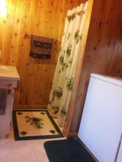 Bathroom with washer and dryer.