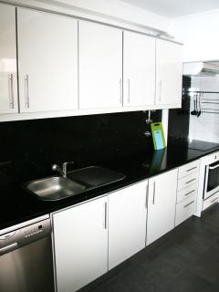 Fully equipped kitchen w/ oven, dish washer, fridge, microwave etc.