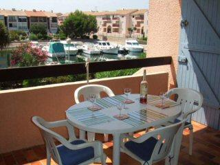 7sqm Sunny West Facing balcony with views of the Gardens and Petite Marina