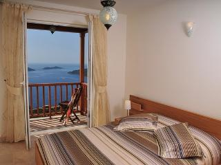 Master bedroom with sea view balcony