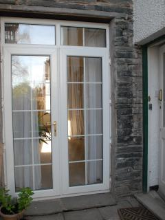 Entrance door and french windows from the patio.