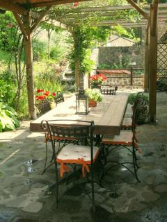 the semi covered patio area offers some welcome shade for al fresco dining