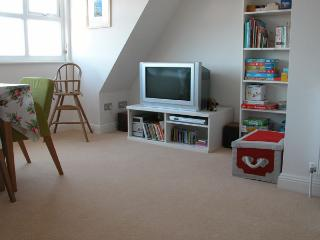 Lots of toys, books and games. Our TV has been updated since photo - is larger and flat screen!