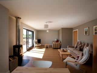 Open plan living space, wood burning stove, doors to patio,great views across open countryside
