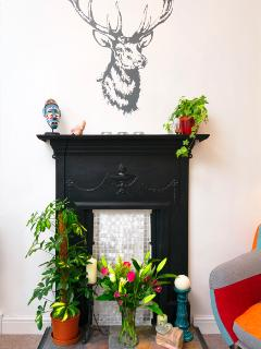 Victorian fireplace (decorative). The apartment boasts modern gas central heating.