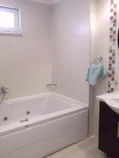 Ensuite Jacuzzi bath ; one of two bathrooms, the other with walk in shower