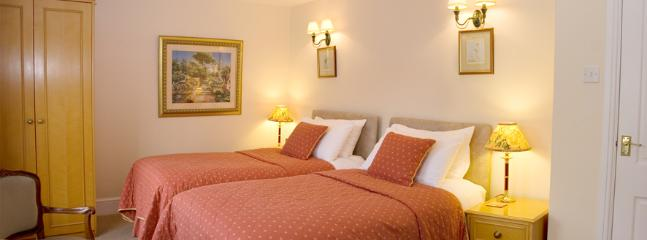 Main bedroom with bed which can be linked to produce a super king double
