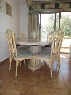 Dining area with large table 6 dining chairs