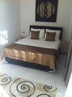 Master bedroom, with en-suite and private balcony overlooking the sea