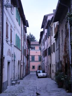 Small cobbled street where house is located within the walls of the historical centre - beautiful!!