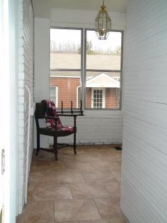 Back enclosed heated and air conditioned porch.