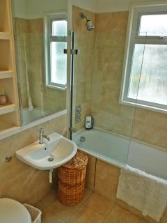 New modern bathroom with shower and bath
