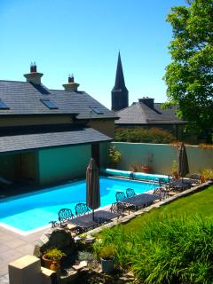 View of the pool area from the back garden
