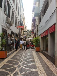 Street of the building, with shops and cafes