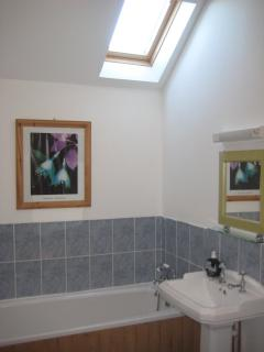 Bright and spacious bathroom with  bath and separate shower cubical