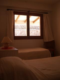 Twin bedroom in evening light