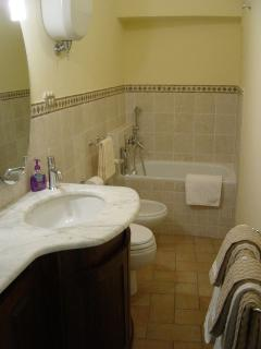 Main bathroom in addition to ensuite, located on level 2 at top of first level stairs.