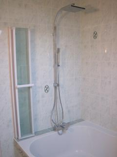 Corner bath with shower above