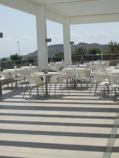Outdoor terrace at Alenda golf serving tapas, meals & drinks, lovely views of mountains & co