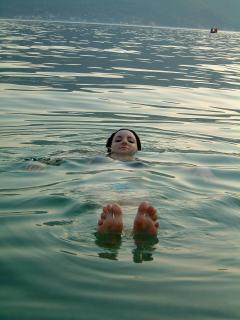 Floating in the clean, warm, salty water of the Bay of Kotor at Orahovac
