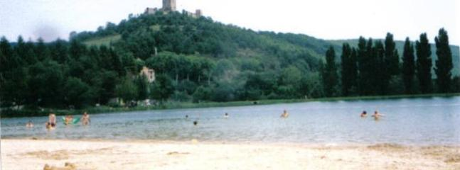 Puivert swimming lake and castle on hill, summer.