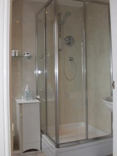 Bright and modern en-suite shower room for the double room.