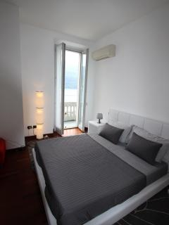 The bedroom also has a door leading onto the balcony